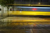 Long exposure traffic on road and pedestrian crossing — Stock Photo