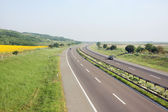 Highway driving in good sunny weather — Stock Photo