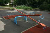 Playground children's child seesaws teeter on summer kids playground — Stock Photo