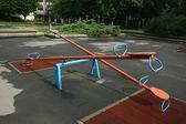 Playground children's child seesaws teeter on summer kids playground — Stock Photo