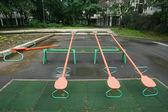 Playground children's child seesaws teeter on summer kids playgr — Stock Photo