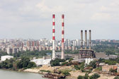 Chimneys of the heating plants, Heating plant in the city by the river — Stock Photo