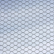 Metal wire fence protection isolated on sky for background — Stock Photo #44525763