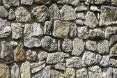 Large wall from the old stone — Stock Photo