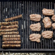 Chopped meat kebapcheta, meatballs, charcoal grill — Stock Photo #22786624