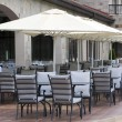Restaurant tables chares umbrellas — Stock Photo