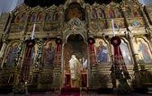 Orthodox iconostasis and priest — Stock Photo
