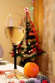 Сhampagne, mandarin and Christmas tree — Stock Photo