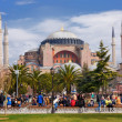 Stock Photo: Istanbul, Turkey - March 9, 2013: Visitors in Sultanahmet Square, HaghiSophiis in background