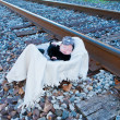Baby Sleeping in Basket by Railroad — Stock Photo