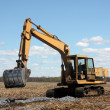 Excavator on cultivated land — Stock Photo
