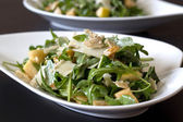 Arugula salad with apple and pasmesan — Stock Photo