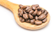 Wooden Spoon With Coffee Beans On White Background — Stock Photo