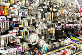 Kitchen Utensils On Supermarket Shelf — Stock Photo
