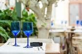 Empty Blue Glasses On Restaurant Table — Stock Photo