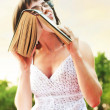 Geek girl with with book - Stock Photo