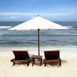 Beach chair and umbrella on sand beach. Concept for rest, relaxa — Stock Photo
