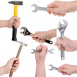 Set of hands holding working tools — Stock Photo