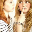 Red haired and blond girl sign to shut up — Stock Photo