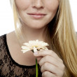 Young beautiful blond haired girl playing he loves me — Stock Photo