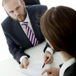 Stock Photo: Beard business man brunette woman at desk sign contract