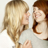 Blond and red haired girls are laughing — Photo