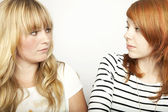 Blond and red haired girl are upset — Stock Photo