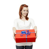 Young beautiful red haired girl has a gift for you — Stock Photo