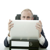 Business man hide behind laptop and documents — Stock Photo