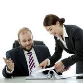 Beard business man brunette woman at desk confuse — Stock Photo