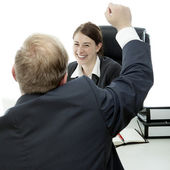 Beard business man woman at desk raise arms in the air and is happy — Stock Photo