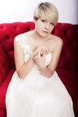 Young short haired blonde girl with bridal dress — Stock Photo