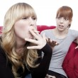 Young beautiful blond and red haired girls is shocked about frie — Stock Photo #20865269