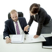 Beard business man brunette woman at desk explain documents — Stock Photo