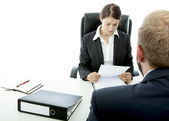 Beard business man brunette woman at desk read contract — Stock Photo