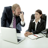 Beard business man brunette woman at desk think employee is stupid — Stock Photo