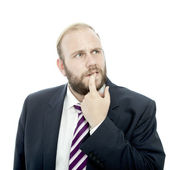 Beard business man is thinking and unsure — Stock Photo
