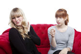 Young beautiful blond and red haired girls is disgusting becuase — Stock Photo