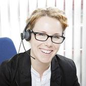 Happy woman wearing a headset — Stock Photo