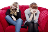 Young beautiful blond and red haired girls are bored and depress — Stock Photo
