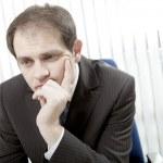 Depressed businessman thinking — Stock Photo