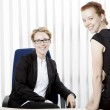Two happy young women in an office — Stock Photo