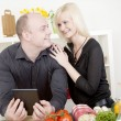 Affectionate couple preparing a meal — Stock Photo #22725059