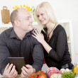 Stock Photo: Affectionate couple preparing a meal