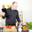 Stock Photo: Mcooking in kitchen