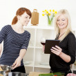 Female friends cooking in the kitchen — Stock Photo