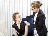 Supervisor talking to an employee — Stock Photo