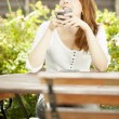 Attractive redhead woman daydreaming — Stock Photo