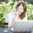 Woman working from home sitting outdoors — Стоковая фотография