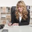 Young blond attractive business woman — Stock Photo